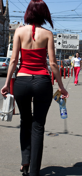 A hot woman walking on the street in Romania