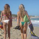 cute women's back in bikini at the beach